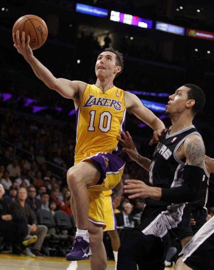 Los Angeles Lakers guard Steve Nash (10) shoots as San Antonio Spurs guard Danny Green, right, defends in the first quarter during an NBA basketball game Friday, Nov. 1, 2013, in Los Angeles. Photo: Alex Gallardo, Associated Press