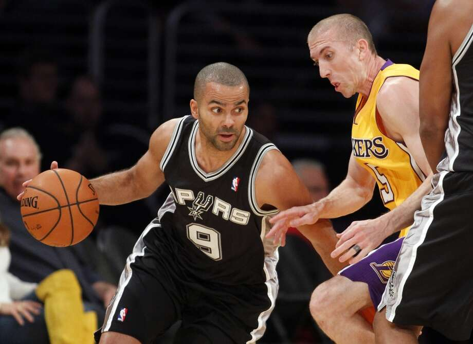 San Antonio Spurs guard Tony Parker, left, of France, dribbles around Los Angeles Lakers' Steve Blake in the first quarter during an NBA basketball game Friday, Nov. 1, 2013, in Los Angeles. Photo: Alex Gallardo, Associated Press