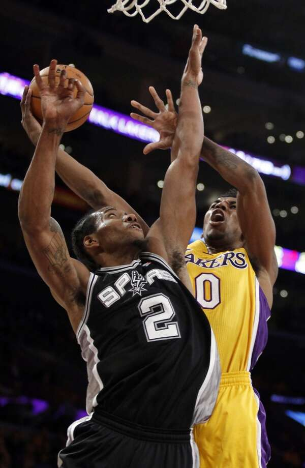 San Antonio Spurs forward Kawhi Leonard (2) defends as Los Angeles Lakers guard Nick Young (0) shoots during the first quarter of an NBA basketball game Friday, Nov. 1, 2013, in Los Angeles. Photo: Alex Gallardo, Associated Press