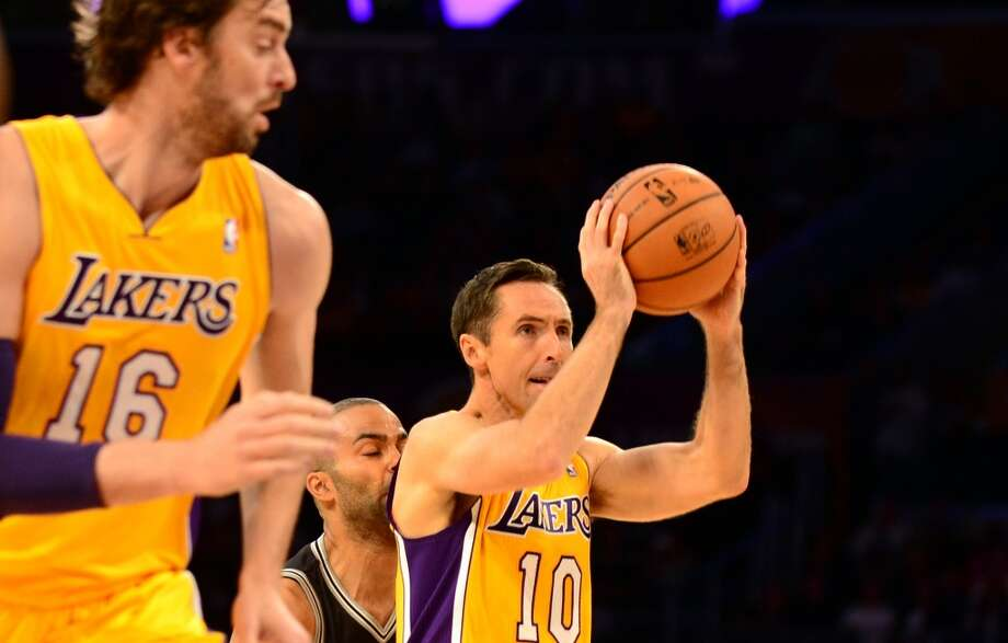 Tony Parker of the San Antonio Spurs runs into Steve Nash of the Los Angeles Lakers as he prepares to shoot as Pau Gasol (L) runs beside him during NBA action on November 1, 2013 in Los Angeles, California. Photo: FREDERIC J. BROWN, AFP/Getty Images