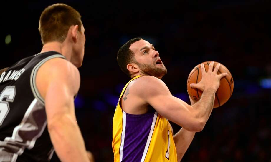 Jordan Farmar of the Los Angeles Lakers looks to shoot under pressure from Aron Baynes of the San Antonio Spurs (L) during NBA action on November 1, 2013 in Los Angeles, California. Photo: FREDERIC J. BROWN, AFP/Getty Images