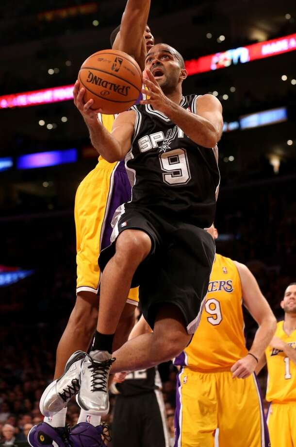 LOS ANGELES, CA - NOVEMBER 01:  Tony Parker #9 of the San Antonio Spurs shoots against the Los Angeles Lakers at Staples Center on November 1, 2013 in Los Angeles, California.  NOTE TO USER: User expressly acknowledges and agrees that, by downloading and or using this photograph, User is consenting to the terms and conditions of the Getty Images License Agreement.  (Photo by Stephen Dunn/Getty Images) Photo: Getty Images