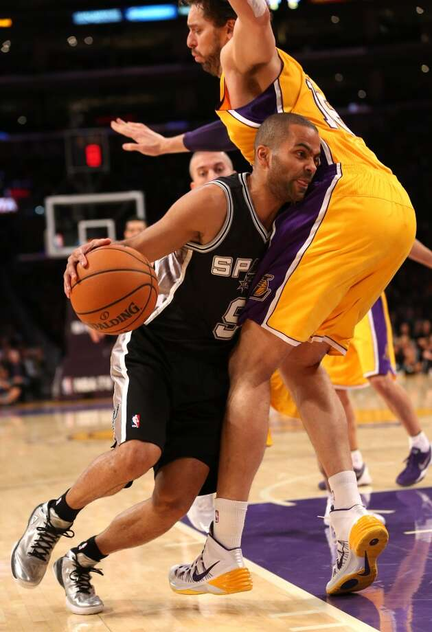 LOS ANGELES, CA - NOVEMBER 01:  Tony Parker #9 of the San Antonio Spurs drives against Pau Gasol #16 of the Los Angeles Lakers at Staples Center on November 1, 2013 in Los Angeles, California.  NOTE TO USER: User expressly acknowledges and agrees that, by downloading and or using this photograph, User is consenting to the terms and conditions of the Getty Images License Agreement.  (Photo by Stephen Dunn/Getty Images) Photo: Getty Images