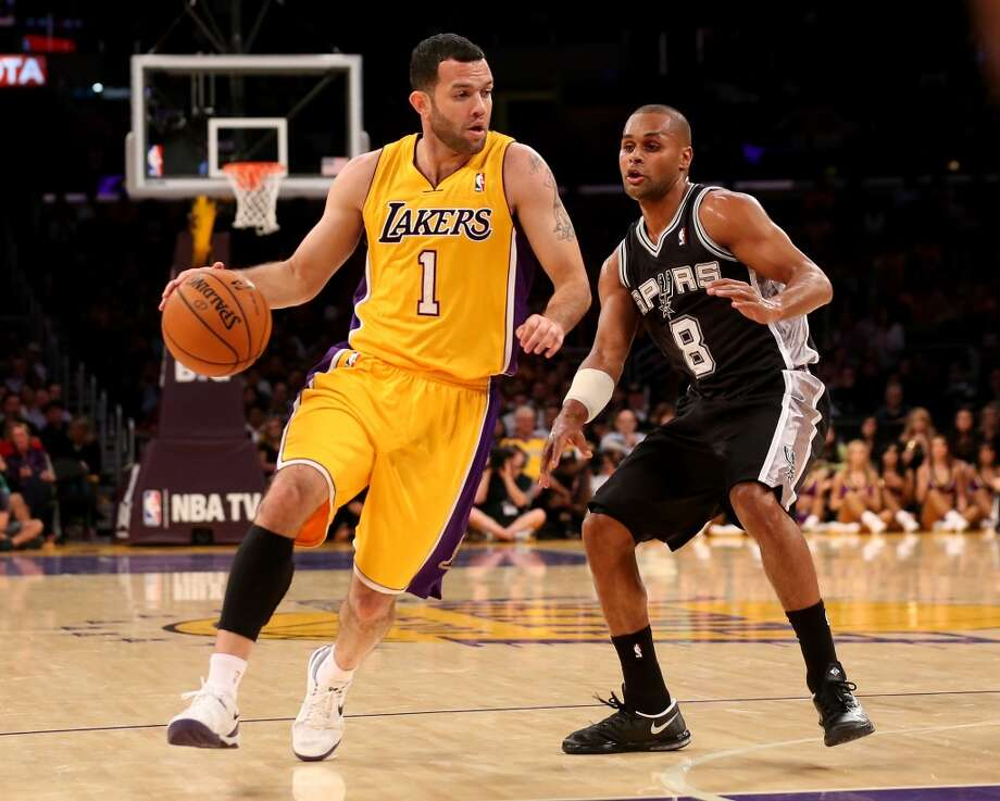 LOS ANGELES, CA - NOVEMBER 01:  Jordan Farmar #1 of the Los Angeles Lakers drives against Patty Mills #8 of the San Antonio Spurs at Staples Center on November 1, 2013 in Los Angeles, California. The Spurs won 91-85.  NOTE TO USER: User expressly acknowledges and agrees that, by downloading and or using this photograph, User is consenting to the terms and conditions of the Getty Images License Agreement.  (Photo by Stephen Dunn/Getty Images) Photo: Getty Images