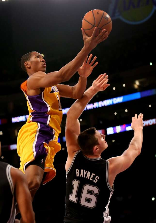 LOS ANGELES, CA - NOVEMBER 01:  Wesley Johnson #11 of the Los Angeles Lakers shoots over Aron Baynes #16 of the San Antonio Spurs at Staples Center on November 1, 2013 in Los Angeles, California. The Spurs won 91-85.  NOTE TO USER: User expressly acknowledges and agrees that, by downloading and or using this photograph, User is consenting to the terms and conditions of the Getty Images License Agreement.  (Photo by Stephen Dunn/Getty Images) Photo: Getty Images