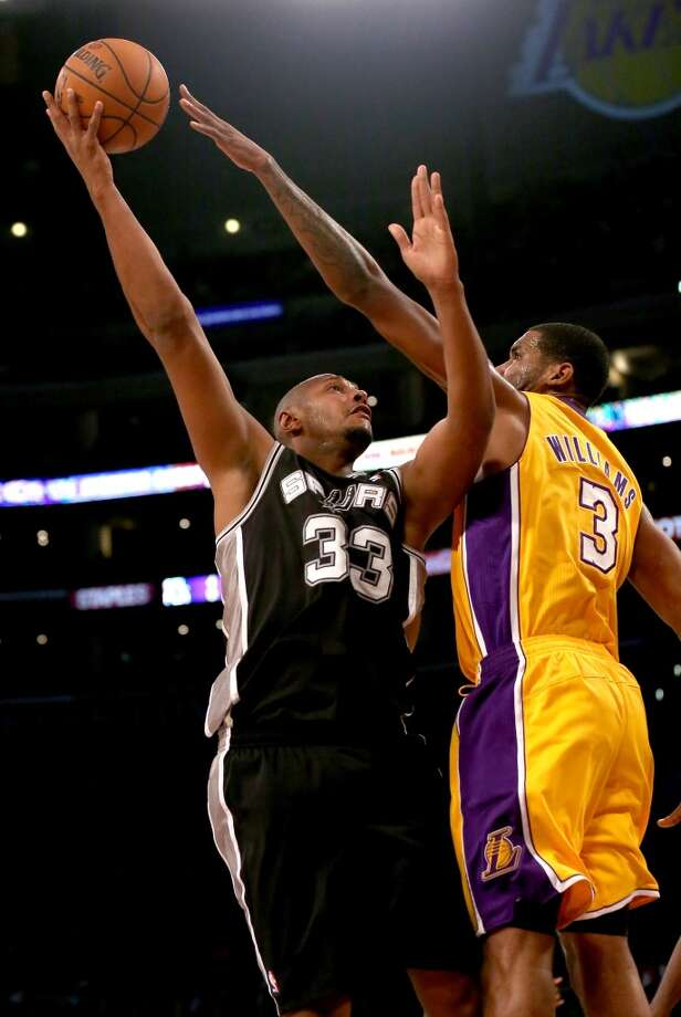 LOS ANGELES, CA - NOVEMBER 01:  Boris Diaw #33 of the San Antonio Spurs shoots over Shawne Williams #3 of the Los Angeles Lakers at Staples Center on November 1, 2013 in Los Angeles, California.  The Spurs won 91-85.  NOTE TO USER: User expressly acknowledges and agrees that, by downloading and or using this photograph, User is consenting to the terms and conditions of the Getty Images License Agreement.  (Photo by Stephen Dunn/Getty Images) Photo: Getty Images