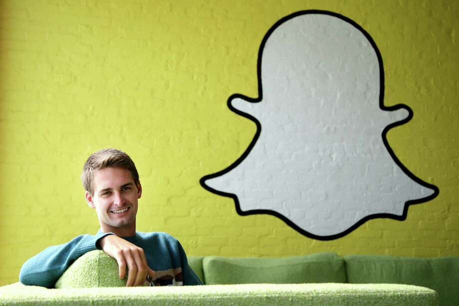 In this Thursday, Oct. 24, 2013, Snapchat CEO Evan Spiegel poses for photos, in Los Angeles. Spiegel dropped out of Stanford University in 2012, three classes shy of graduation, to move back to his father's house and work on Snapchat. Spiegel's fast-growing mobile app lets users send photos, videos and messages that disappear a few seconds after they are received (AP Photo/Jae C. Hong) Photo: Jae C. Hong, STF / AP