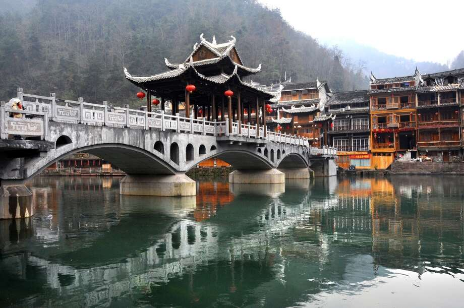 """9. Hunan, China:A """"gleaming new network of high-speed trains, superhighways and regular direct flights,"""" as Lonely Planet puts it, is    making it easier to enjoy the ancient treasures of China's Hunan province, such as the Wind Bridge of Fenghuang (pictured). Photo: Melinda Chan, Getty Images/Flickr RF"""