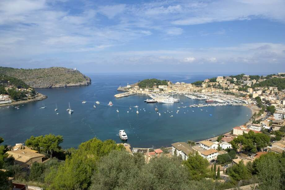 "7. Mallorca, Spain: While boozing British soccer fans frequent some parts of the Balearic isle known locally as Majorca,  Lonely Planet hails the island's ongoing reinvention as a ""more genteel'"" destination. One top attraction: the gorgeous northwest coast, including Puerto de Soller (pictured) and the Serra da Tramuntana mountain range. Photo: Manchan, Getty Images"