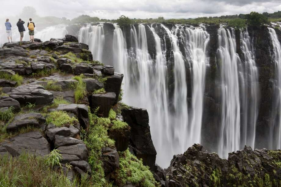 """6. Victoria Falls, Zimbabwe and Zambia:The majestic waterfall (seen from Zimbabwe) provides an """"all-round sensory encounter with Mother Nature,'""""according to Lonely Planet. The falls' two tourism centers -- Zimbabwe's Victoria Falls and Zambia's Livingstone -- recently received major makeovers before hosting the UN's World Tourism  Organization. Photo: JoSon, Getty Images"""