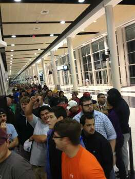 The lines continue on inside the Reliant Center. (John Gonzales / Houston Chronicle)