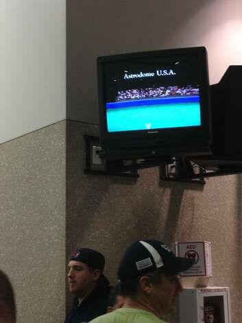 While waiting in line, crowds were entertained by a nostalgic trip down memory lane on TV monitors in Reliant Center. (John Gonzales / Houston Chronicle)
