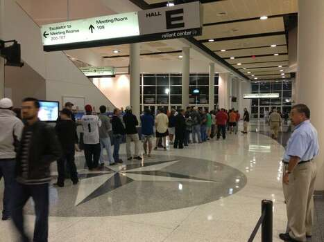 People continue to flood in for the sale at Reliant Center around 7 a.m. (John Gonzales / Houston Chronicle)
