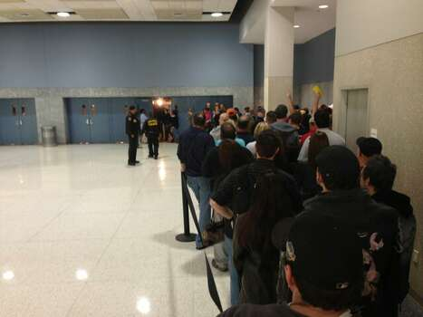 The line just outside the Astrodome sales floor at Reliant Center. (John Gonzales / Houston Chronicle)
