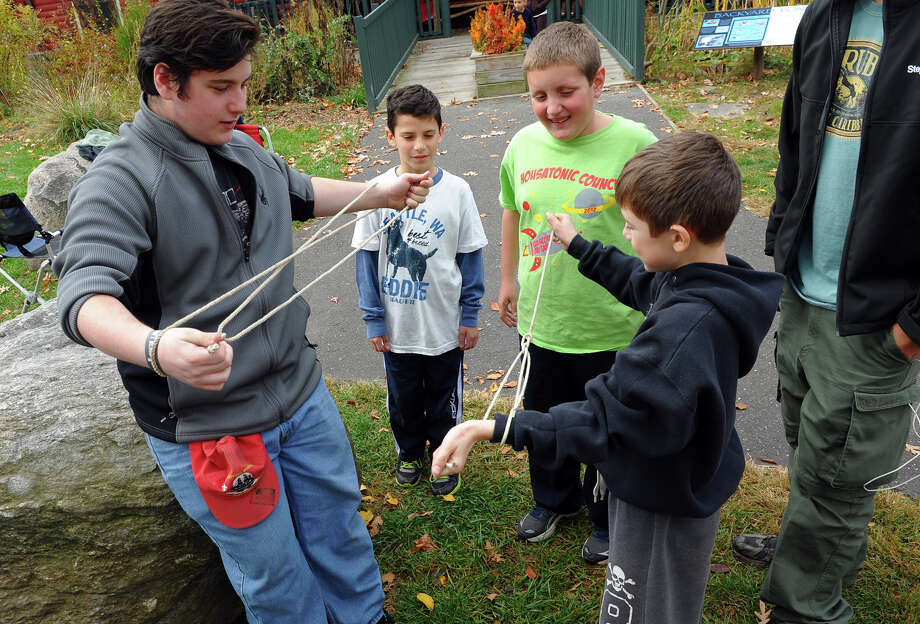 Boy Scouts from Troop 68 in Trumbull and cub scouts from several local packs enjoy lunch and activities after taking part in their annual service project, in this case, taking apart the zoo's Halloween maze at Beardsley Zoo in Bridgeport, Conn. on Saturday November 2, 2013. They also prepared three turkey's and all the side dishes for a Thanksgiving dinner later in the evening. Photo: Christian Abraham / Connecticut Post