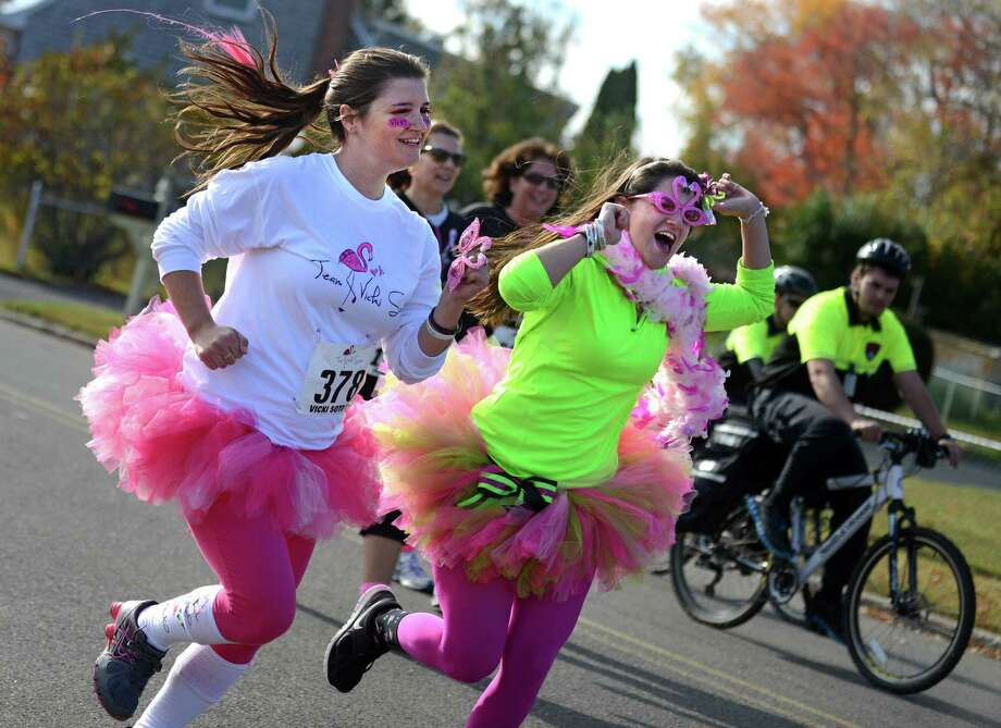 Heather Cronk, left, and Carlee Soto, family members of Victoria Soto, run in the first annual Vicki Soto 5K through the Lordship section of Stratford Saturday, Nov. 2, 2013.  The fun run benefits the Vicki Soto Memorial Fund which raises money to support students that want to become educators. Photo: Autumn Driscoll / Connecticut Post