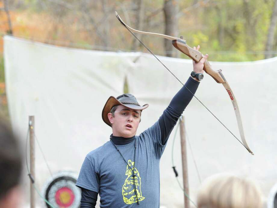 "Archery instructor Kevin Gillick of Greenwich gives a lesson in how to hold a bow during the Greenwich Scouts ""Turkey Shoot"" event at Seton Scout Reservation in Glenville, Saturday, Nov. 2, 2013. Photo: Bob Luckey / Greenwich Time"