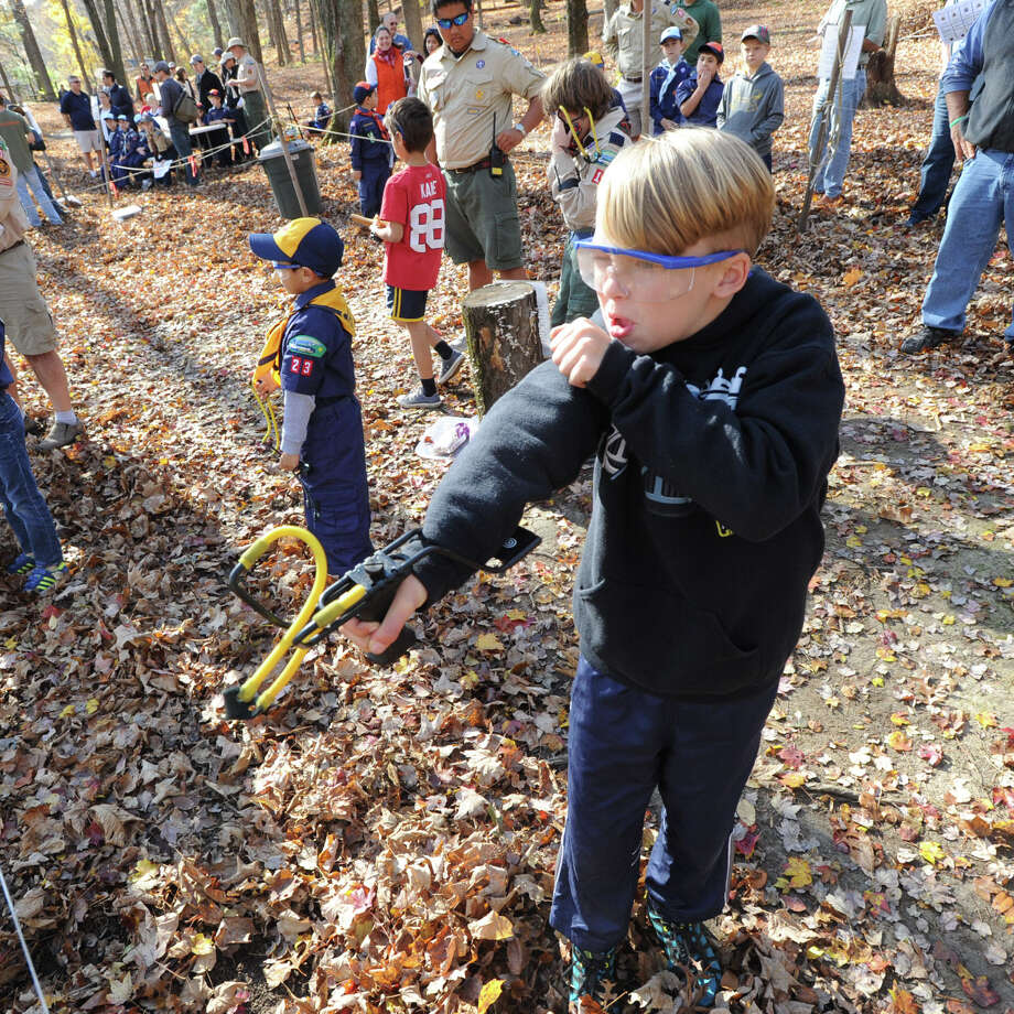 "Greenwich Cub Scout Gunther Krieg, 8, of Cos Cob uses a slingshot during the ""Turkey Shoot"" event at Seton Scout Reservation in Glenville, Saturday, Nov. 2, 2013. Krieg is a member of Cub Scout Pack 23. Photo: Bob Luckey / Greenwich Time"