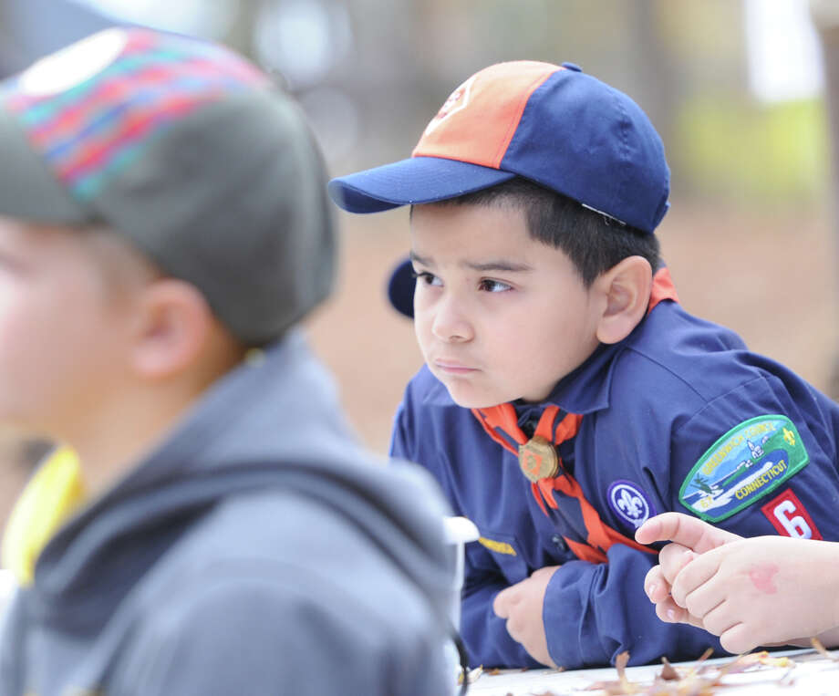 "Greenwich Cub Scout Kevin Barrios, 6, listens to an archery instructor talk about safety during the ""Turkey Shoot"" event at Seton Scout Reservation in Glenville, Saturday, Nov. 2, 2013. Photo: Bob Luckey / Greenwich Time"