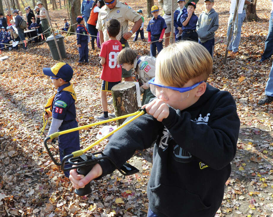 "Greenwich Cub Scout Gunther Krieg, 8, of Cos Cob uses a slingshot during the ""Turkey Shoot"" event at Seton Scout Reservation in Glenville, Saturday, Nov. 2, 2013. Krieg said he is a member of Cub Scout Pack 23. Photo: Bob Luckey / Greenwich Time"
