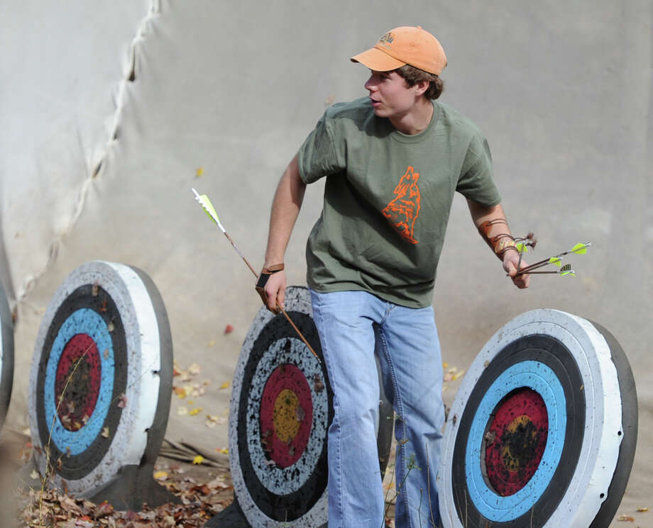 "Boy Scout archery instructor, Jack Smith of Rye, N.Y., retrieves arrows during the Greenwich Scouts ""Turkey Shoot"" event at Seton Scout Reservation in Glenville, Saturday, Nov. 2, 2013. Photo: Bob Luckey / Greenwich Time"