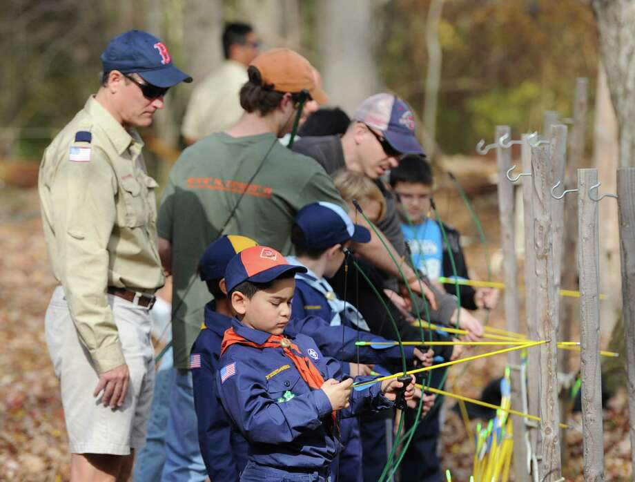 "Greenwich Cub Scout Kevin Barrios, 6, loads an arrow into a bow during the ""Turkey Shoot"" event at Seton Scout Reservation in Glenville, Saturday, Nov. 2, 2013. Photo: Bob Luckey / Greenwich Time"