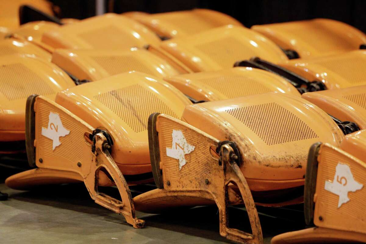 Orange Astrodome seats are shown at Reliant Center during the auction and sale of Astrodome items at Reliant Center Saturday, Nov. 2, 2013, in Houston.