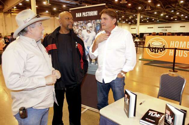 Houston Oilers quarterback Dan Pastorini, right, talks with Oilers staff member, Mike Harmeier, left, and Oilers player, Arthur Stringer, center, during the auction and sale of Astrodome items at Reliant Center Saturday, Nov. 2, 2013, in Houston. Pastorini there signing copies of his book, Taking Flak: My Life in the Fast Lane. Photo: Melissa Phillip, Houston Chronicle / © 2013  Houston Chronicle