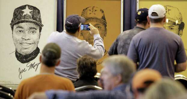 A print of Astros Joe Morgan is shown among other prints of players as people look at items before auction of Astrodome items at Reliant Center Saturday, Nov. 2, 2013, in Houston. Photo: Melissa Phillip, Houston Chronicle / © 2013  Houston Chronicle