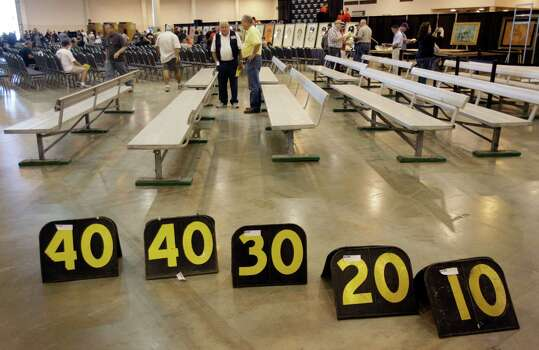 Houston Oilers sideline benches and football yard markers are shown before auction of Astrodome items at Reliant Center Saturday, Nov. 2, 2013, in Houston. Photo: Melissa Phillip, Houston Chronicle / © 2013  Houston Chronicle