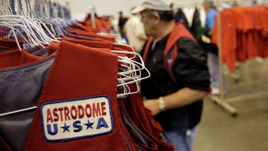 Astrodome personnel vests hang among a variety of Astrodome items shown during sale at Reliant Center Saturday, Nov. 2, 2013, in Houston. Photo: Melissa Phillip, Houston Chronicle / © 2013  Houston Chronicle