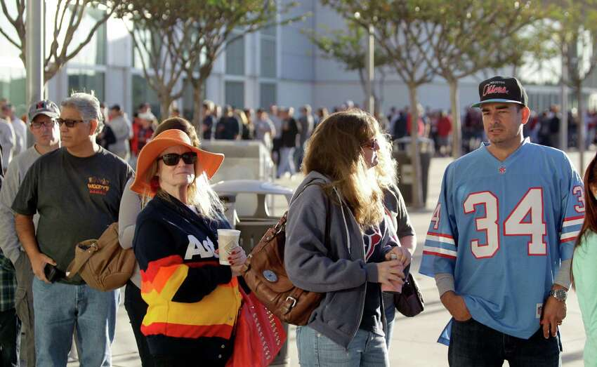 Dene Hofheinz, second from left, whose father the late Judge Roy Hofheinz was the mastermind behind the Astrodome, stands in line with other fans including Leon Barrera, right, wearing an Oiler's Earl Campbell jersey, as they wait outside to enter into Reliant Center for the sale and auction of Dome seats, turf and other items Saturday, Nov. 2, 2013, in Houston. She was excited by the turn out. She said,