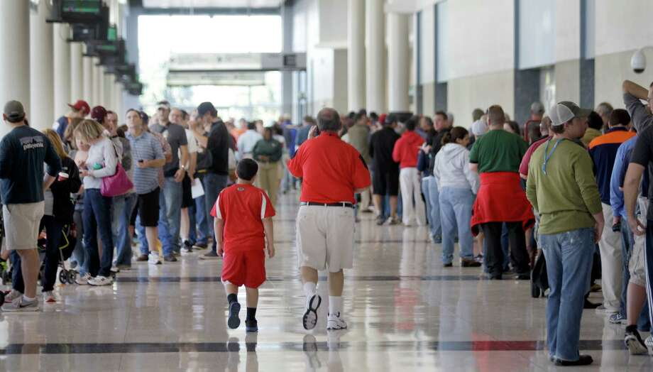 Lines of people fill the lobby of Reliant Center as they wait enter for the auction and sale of Astrodome items at Reliant Center Saturday, Nov. 2, 2013, in Houston. Photo: Melissa Phillip, Houston Chronicle / © 2013  Houston Chronicle