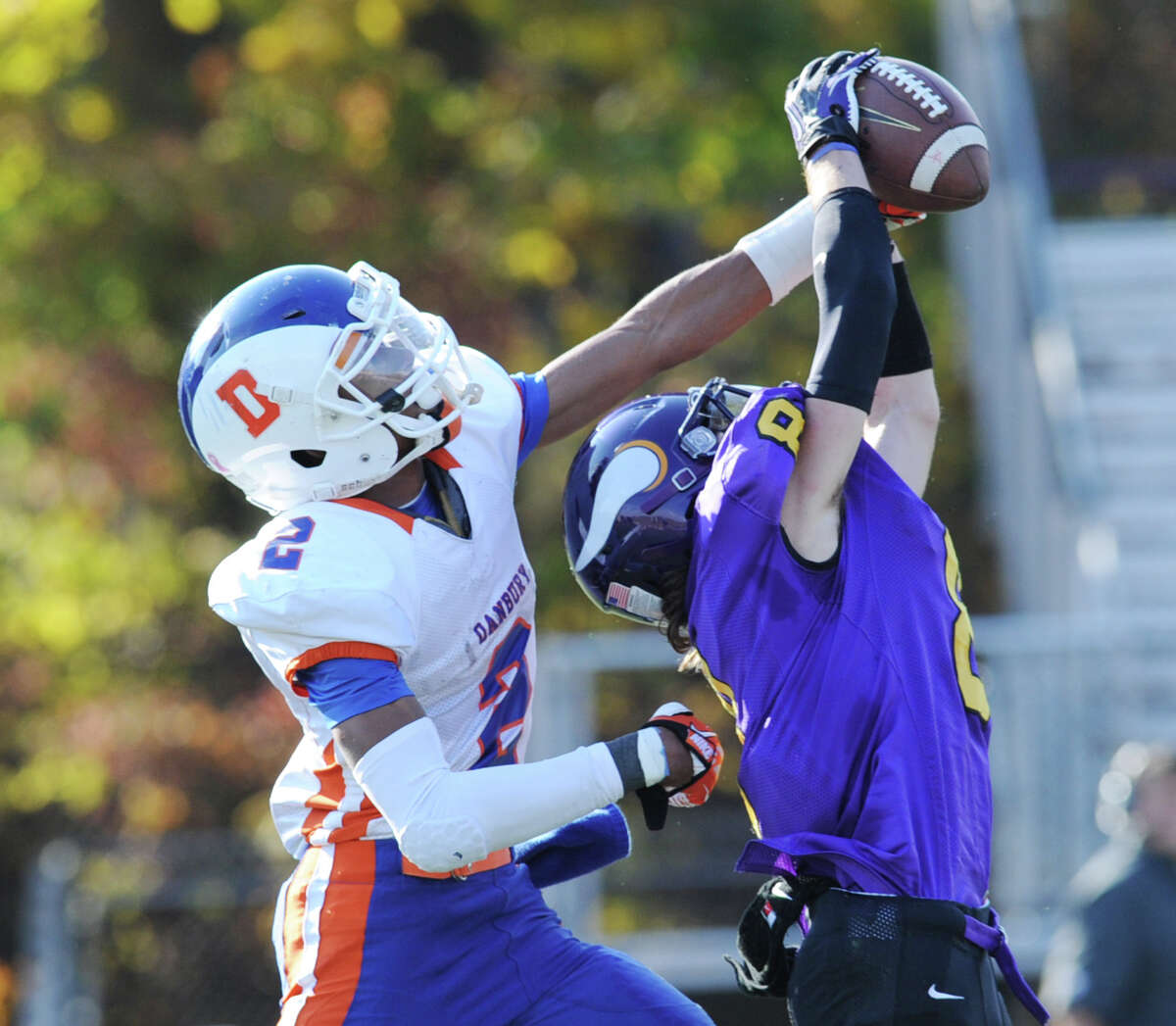 Danbury's Elijah Duffy,(# 2), left, attempts to break up a pass to Westhill wide receiver Dante Fargnoli (# 8) right, who makes the catch during the second quarter of the high school football game between Westhill High School and Danbury High School at Westhill High School in Stamford, Saturday, Nov. 2, 2013.