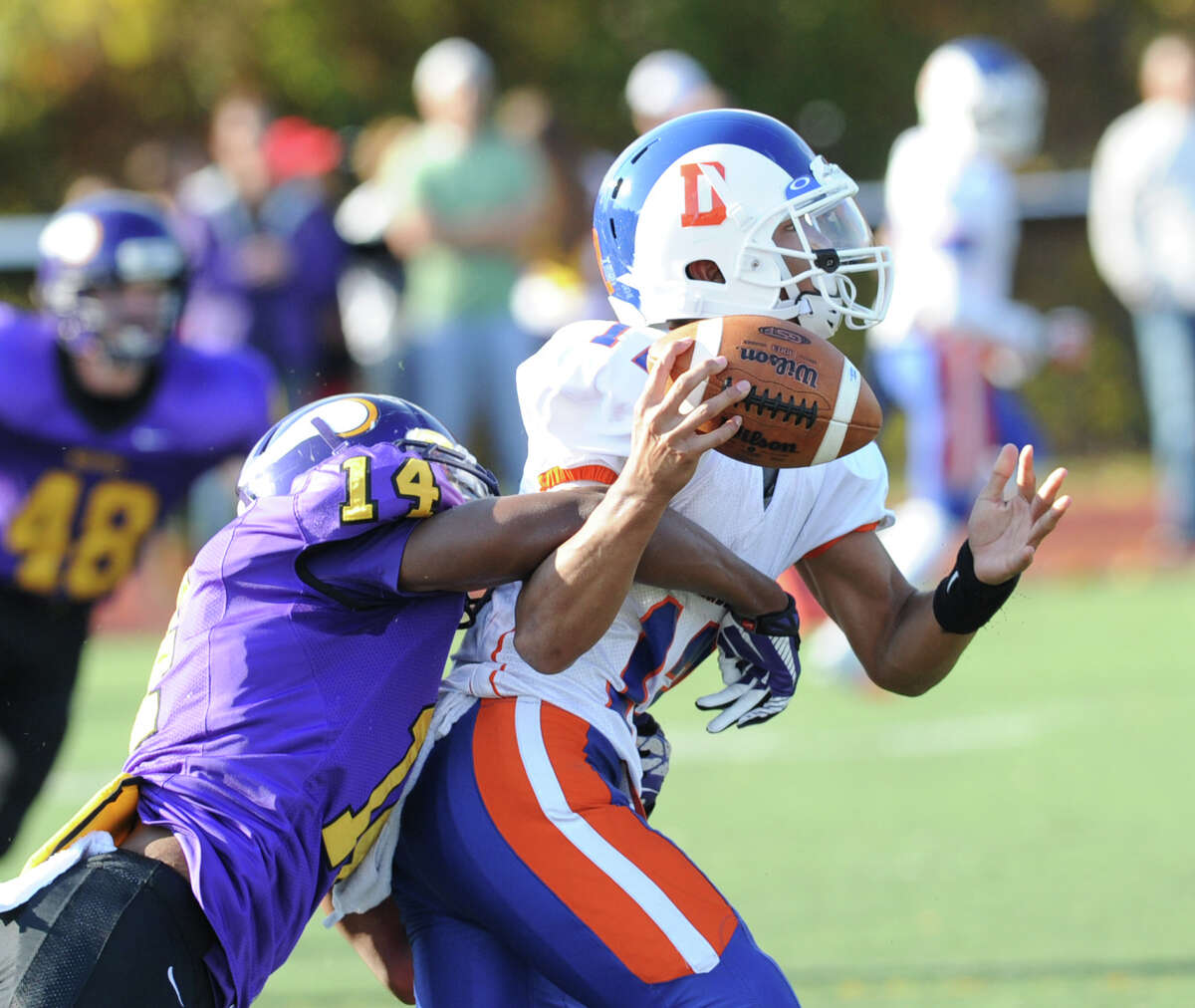 Westhill's Chianta Holtzclaw (# 14) hits Danbury quarterback Anferny Ith causing a second quarter fumble that Westhill recovered during the High school football game between Westhill High School and Danbury High School at Westhill High School in Stamford, Saturday, Nov. 2, 2013.