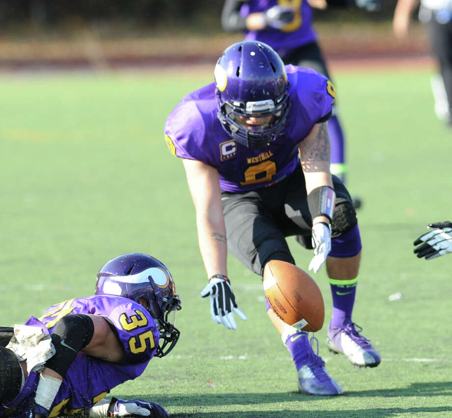 Dennis Hart-Lima (# 9) of Westhill recovers a fumble during the high school football game between Westhill High School and Danbury High School at Westhill High School in Stamford, Saturday, Nov. 2, 2013. At left is Zac Cowit (# 35) of Westhill. Photo: Bob Luckey / Greenwich Time