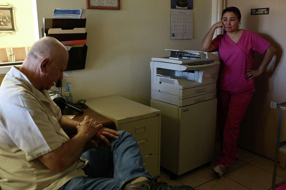 Unable to perform abortions for the first time in over 30 years, Dr. Lester Minto talks with clinic administrator and facility nurse Angie Tristan, right, as they prepare to close for the day at his clinic, Reproductive Services of Harlingen, on Saturday, Nov. 2, 2013. Photo: Lisa Krantz, San Antonio Express-News / San Antonio Express-News