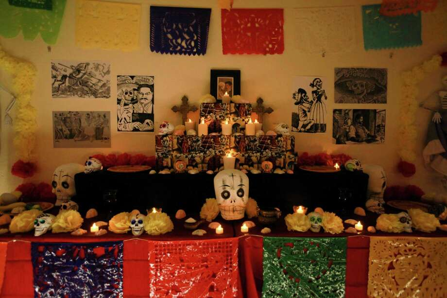 "An traditional ""ofrenda"" or offering is shown at the 9th annual Dia de los Muertos event at El Centro de La Raza on Friday, Nov. 1, 2013. Dia de Los Muertos is a traditional Mexican holiday dedicated to honoring deceased family members. Photo: SOFIA JARAMILLO, SEATTLEPI.COM / SEATTLEPI.COM"