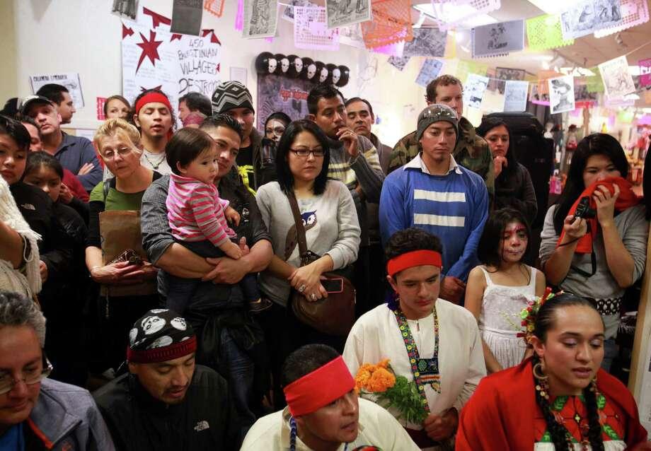 Attendees watch as a traditional Aztec ritual is performed at the 9th annual Dia de los Muertos event at El Centro de La Raza. Photo: SOFIA JARAMILLO, SEATTLEPI.COM / SEATTLEPI.COM