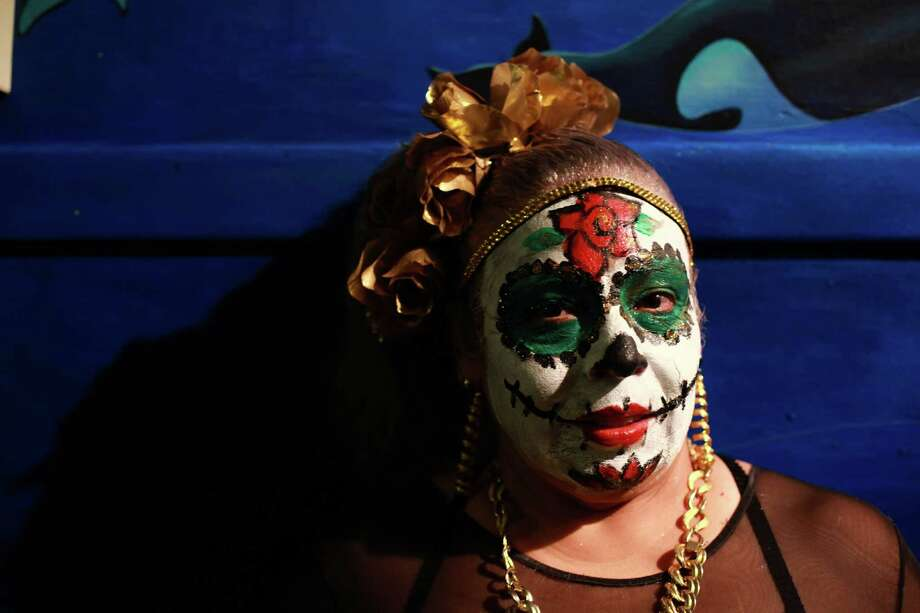 Martha Camarena is shown wearing traditional face paint at the 9th annual Dia de los Muertos event at El Centro de La Raza on Saturday, Nov. 1, 2013. Dia de Los Muertos is a traditional Mexican holiday dedicated to honoring deceased family members. Photo: SOFIA JARAMILLO, SEATTLEPI.COM / SEATTLEPI.COM