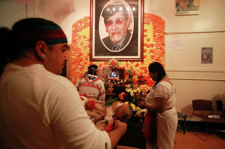 The Ce atl Tonalli dance group performs a traditional Aztec ritual in front of a shrine dedicated to Roberto Maestas, the founder of El Centro de La Raza, at the 9th annual Dia de los Muertos event at El Centro de La Raza. Photo: SOFIA JARAMILLO, SEATTLEPI.COM / SEATTLEPI.COM