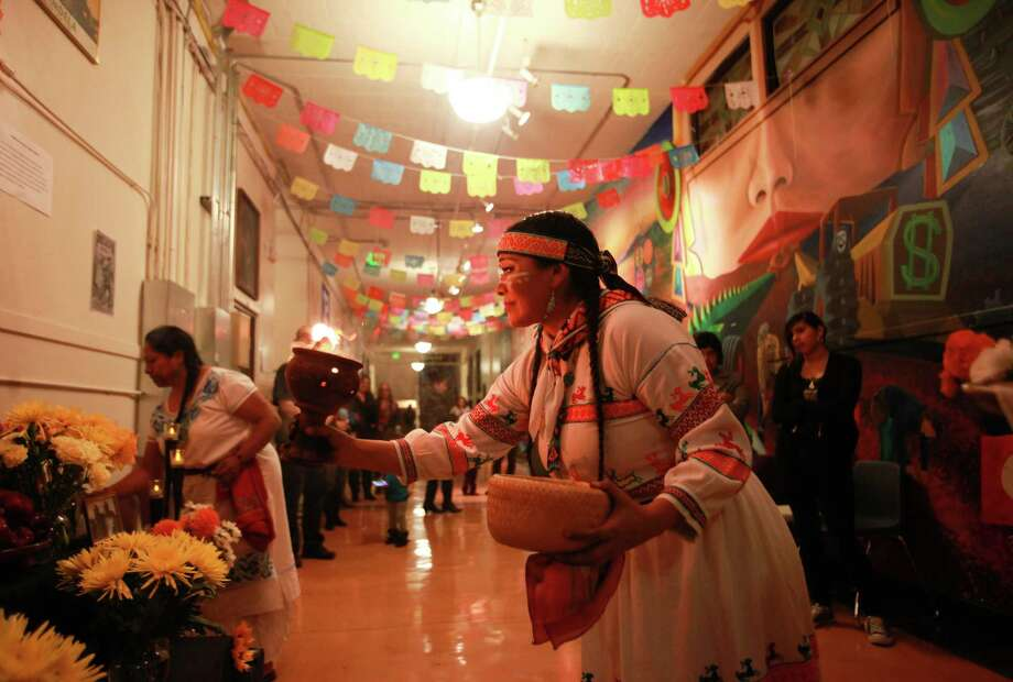 Araceli Jaime performs a traditional Aztec ritual  to give prayer and offerings at the 9th annual Dia de los Muertos event at El Centro de La Raza. Photo: SOFIA JARAMILLO, SEATTLEPI.COM / SEATTLEPI.COM