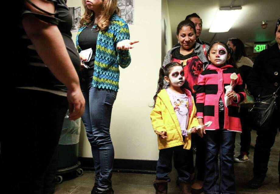 Linda and Lluvia Bautista are shown waiting in line at the 9th annual Dia de los Muertos event at El Centro de La Raza. Photo: SOFIA JARAMILLO, SEATTLEPI.COM / SEATTLEPI.COM