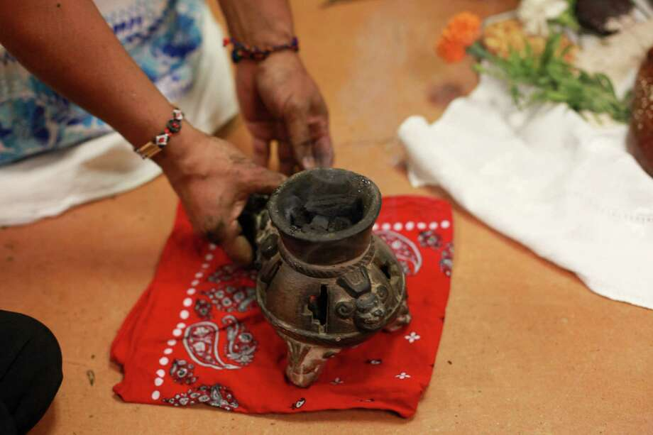 Burning medicinal herbs used for traditional Aztec rituals are shown inside of a Poposchomi goblet at the 9th annual Dia de los Muertos event at El Centro de La Raza. Photo: SOFIA JARAMILLO, SEATTLEPI.COM / SEATTLEPI.COM