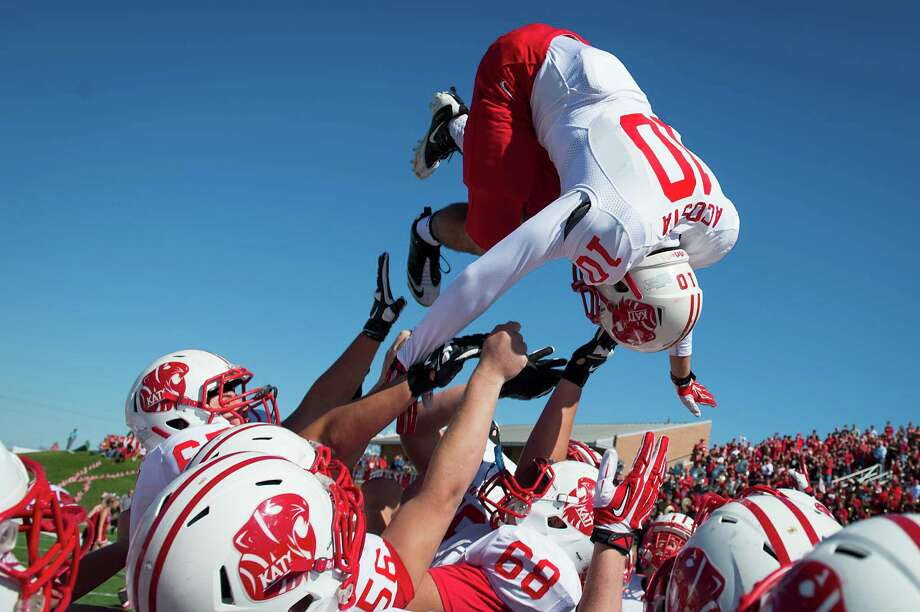 Katy defensive back Lucas Acosta is tossed in the air over his teammates as they take the field for the second half of a high school football game against Cinco Ranch at  Rhodes Stadium, Saturday, Nov. 2, 2013, in Houston. Photo: Smiley N. Pool, Houston Chronicle / © 2013  Houston Chronicle