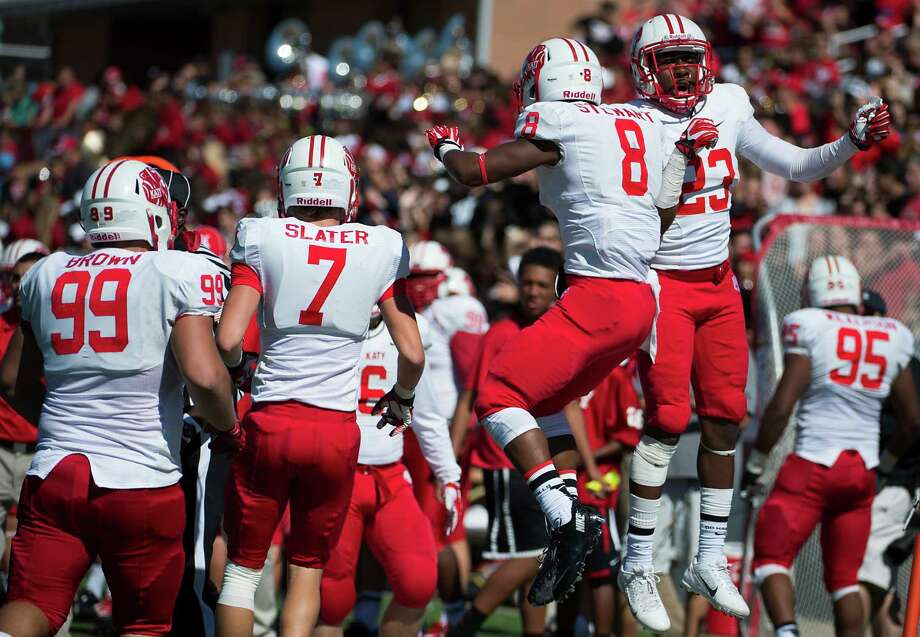 Katy defensive back JoVanni Stewart (8) celebrates with defensive back Josh Blair (23) after intercepting a pass during a high school football game against Cinco Ranch at  Rhodes Stadium, Saturday, Nov. 2, 2013, in Houston. Photo: Smiley N. Pool, Houston Chronicle / © 2013  Houston Chronicle