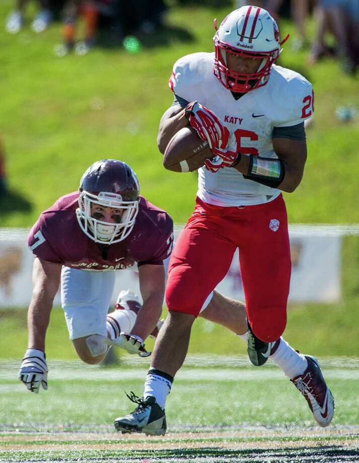 Katy running back Rodney Anderson (26) gets past Cinco Ranch safety Nick Mika (7) to catch a 45-yard touchdown reception during a high school football game at  Rhodes Stadium, Saturday, Nov. 2, 2013, in Houston. Photo: Smiley N. Pool, Houston Chronicle / © 2013  Houston Chronicle