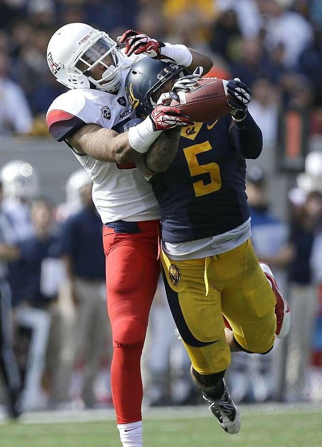 Cal's Michael Lowe breaks up a first-half pass. Photo: Jeff Chiu, Associated Press