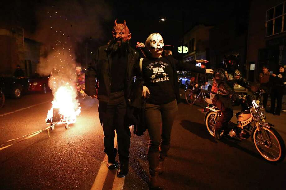 Participants march through the Georgetown neighborhood alongside a flaming coffin during a Day of the Dead funeral march and party on Friday, November 1, 2013. The unique Georgetown event was a twist on the Mexican holiday that traditionally honors the dead. Photo: JOSHUA TRUJILLO, SEATTLEPI.COM / SEATTLEPI.COM