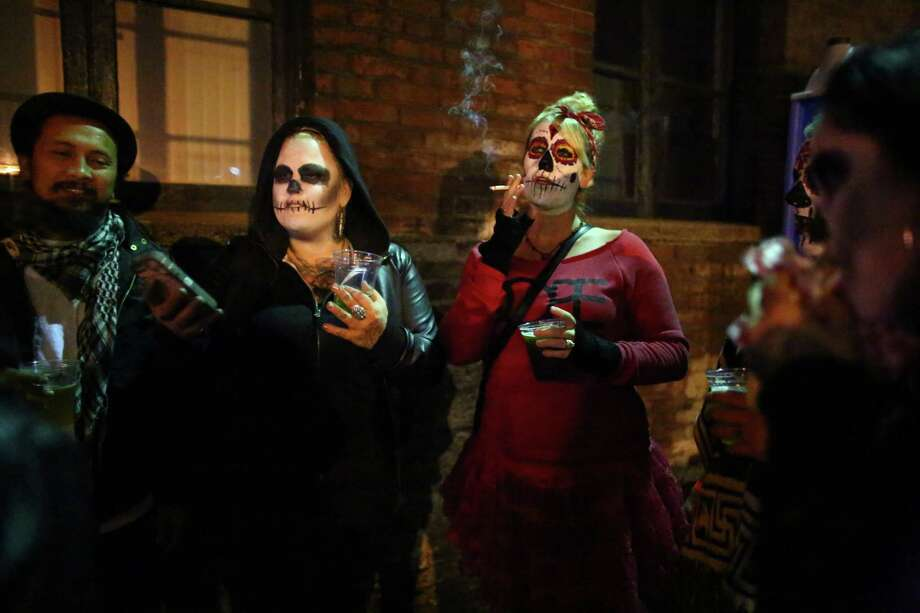 Participants gather at the Machine House Brewery during a Day of the Dead funeral march and party. The unique Georgetown event was a twist on a Latin American day that traditionally honors the dead. Photo: JOSHUA TRUJILLO, SEATTLEPI.COM / SEATTLEPI.COM